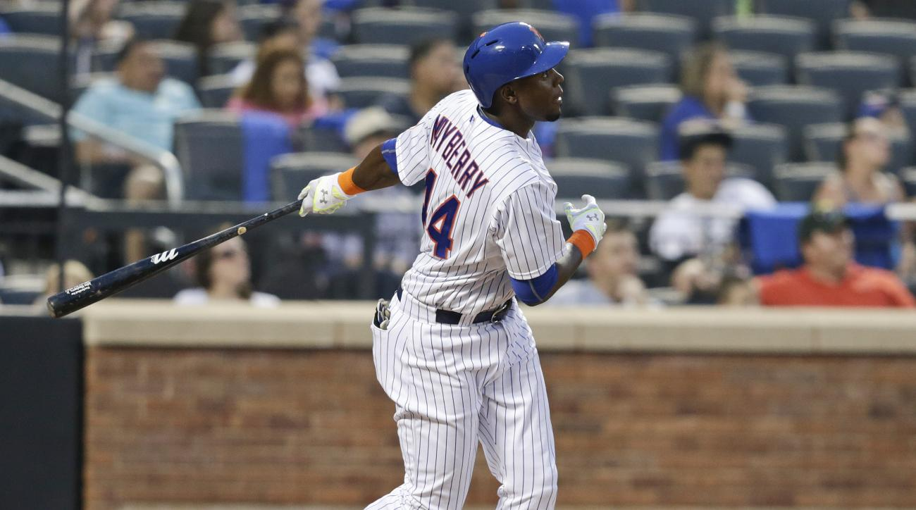 New York Mets' John Mayberry Jr. hits a two-run home run during the fourth inning of a baseball game against the Atlanta Braves, Friday, June 12, 2015, in New York. (AP Photo/Frank Franklin II)