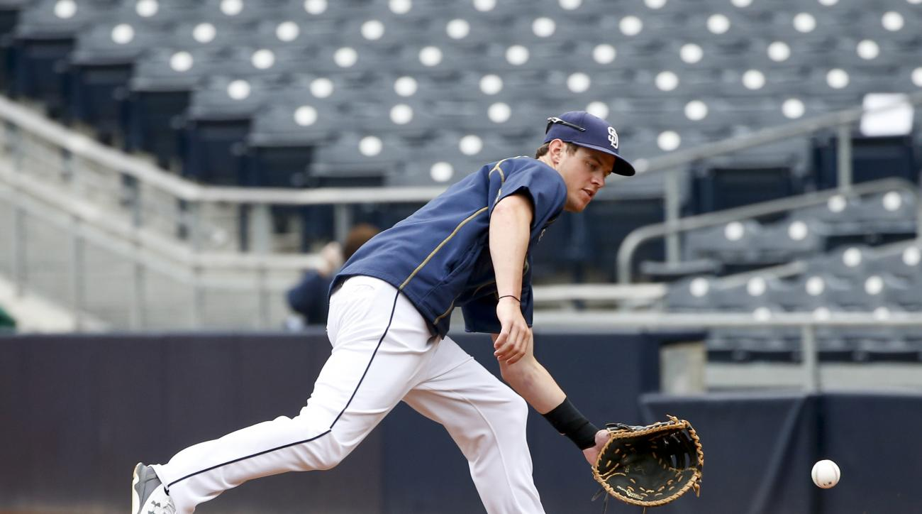 San Diego Padres' Wil Myers goes for a ground ball hit down the line during warm-ups for a baseball game against the Los Angeles Dodgers Friday, June 12, 2015, in San Diego.  (AP Photo/Lenny Ignelzi)