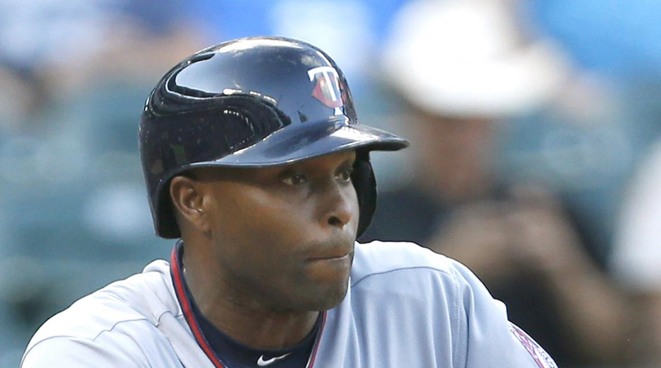Minnesota Twins' Torii Hunter bunts for a single in the first inning of a baseball game against the Texas Rangers, Friday, June 12, 2015, in Arlington, Texas. (AP Photo/Ron Jenkins)