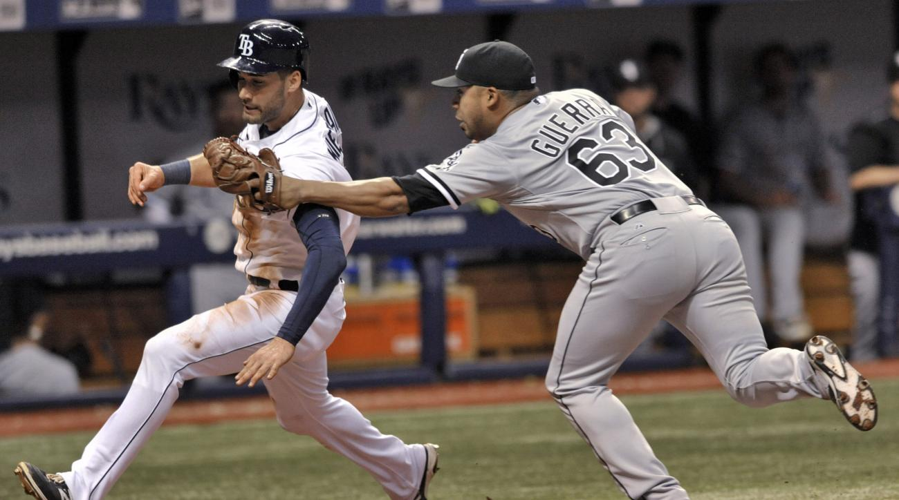Chicago White Sox reliever Junior Guerra (63) tags out Tampa Bay Rays' Kevin Kiermaier in a rundown between home and third base during the eighth inning of a baseball game Friday, June 12, 2015, in St. Petersburg, Fla. The Rays won 7-5. (AP Photo/Steve Ne