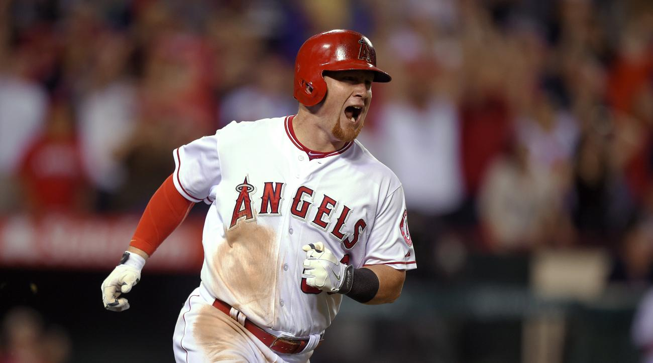Los Angeles Angels' Kole Calhoun celebrates as he runs to first on a solo home run during the eighth inning of a baseball game against the Oakland Athletics, Friday, June 12, 2015, in Anaheim, Calif. (AP Photo/Mark J. Terrill)