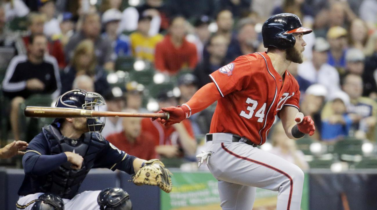 Washington Nationals' Bryce Harper hits an RBI single during the first inning of a baseball game against the Milwaukee Brewers Saturday, June 13, 2015, in Milwaukee. (AP Photo/Morry Gash)
