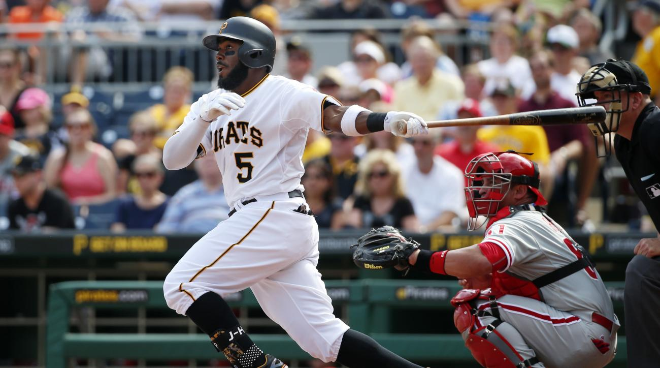 Pittsburgh Pirates' Josh Harrison (5) drives in a run with a single off Philadelphia Phillies starting pitcher Sean O'Sullivan in the first inning of a baseball game in Pittsburgh, Saturday, June 13, 2015. (AP Photo/Gene J. Puskar)