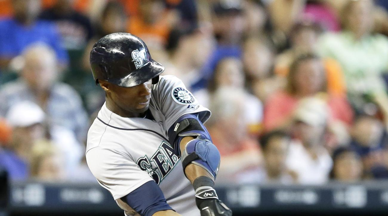 Seattle Mariners' Austin Jackson connects for an RBI single against the Houston Astros in the third inning of a baseball game Saturday, June 13, 2015, in Houston. (AP Photo/Pat Sullivan)