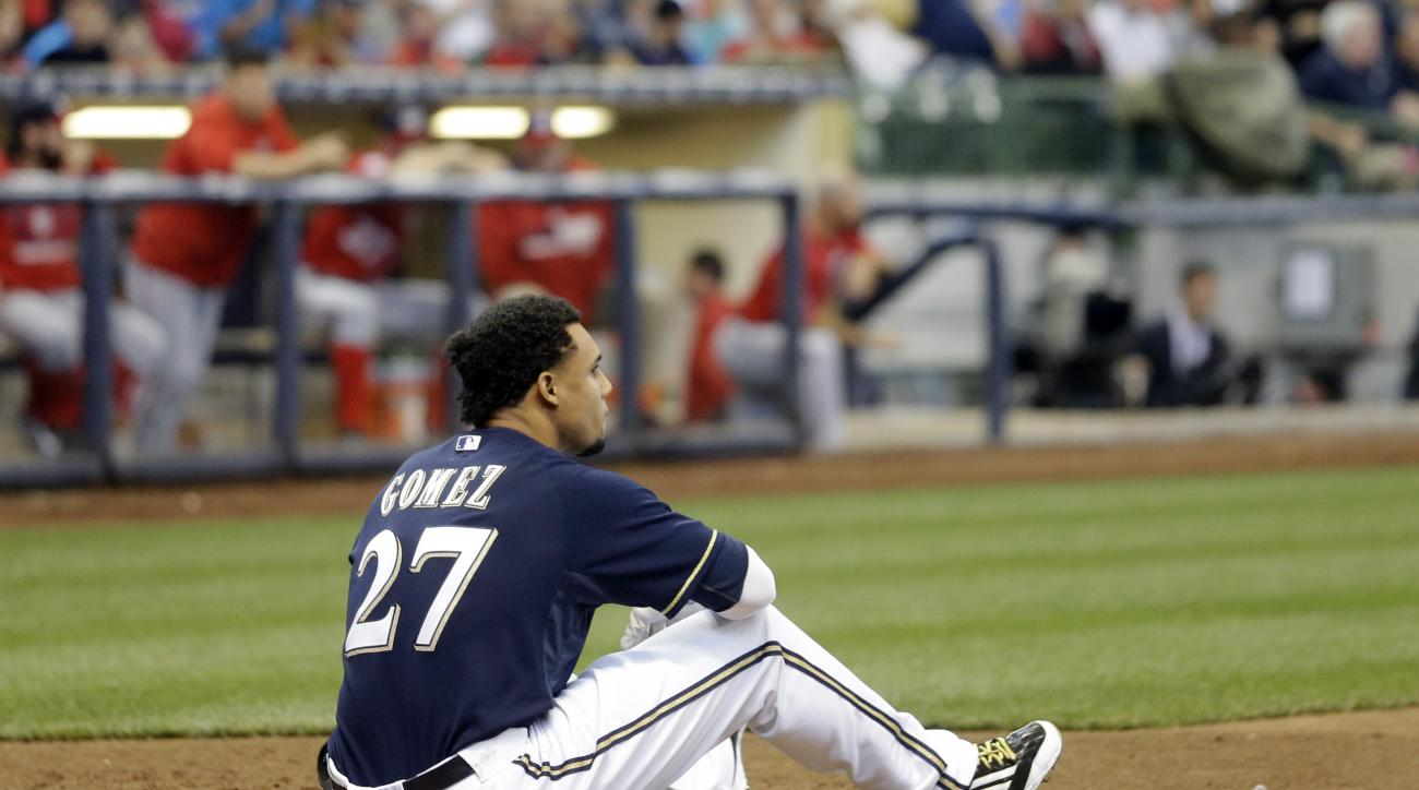 Milwaukee Brewers' Carlos Gomez sits near home after falling down striking out during the seventh inning of a baseball game against the Washington Nationals Saturday, June 13, 2015, in Milwaukee. (AP Photo/Morry Gash)