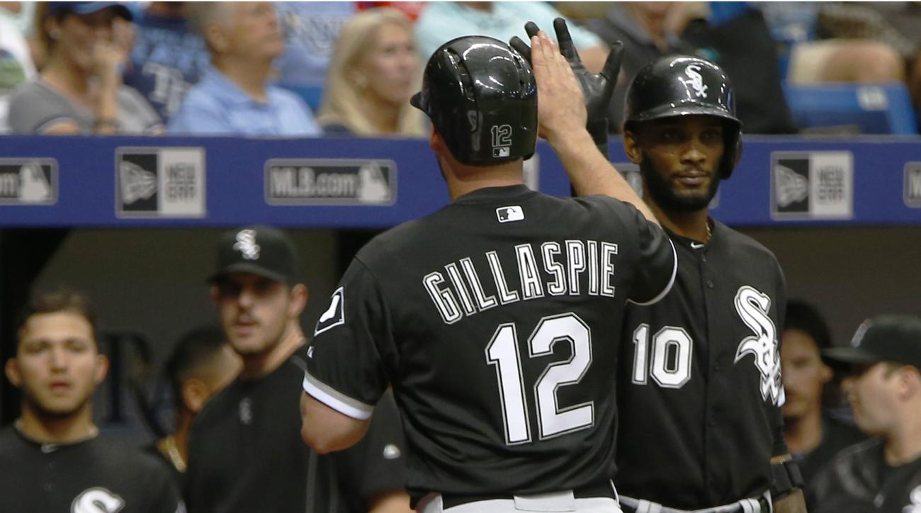 Chicago White Sox third baseman Conor Gillaspie (12), celebrates with shortstop Alexei Ramirez (10) after hitting a two run home run against the Tampa Bay Rays during the eighth inning of a baseball game Saturday, June 13, 2015, in St. Petersburg, Fla. (A
