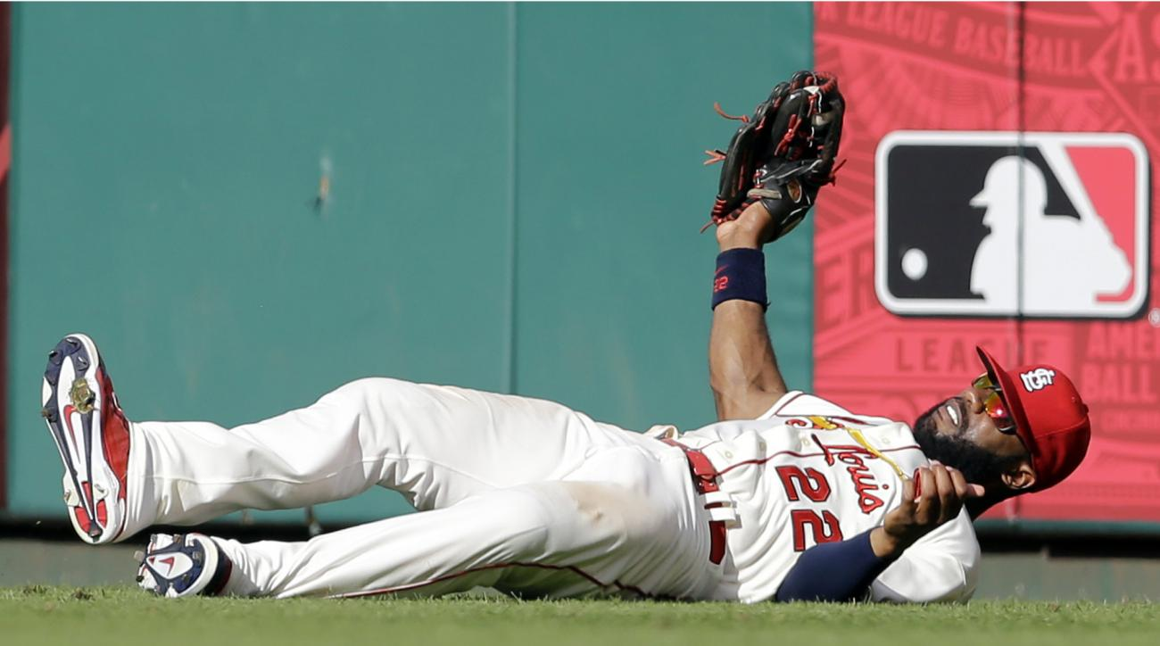 St. Louis Cardinals right fielder Jason Heyward falls as he catches a ball hit by Kansas City Royals' Kendrys Morales for an out during the eighth inning of a baseball game Saturday, June 13, 2015, in St. Louis. (AP Photo/Jeff Roberson)