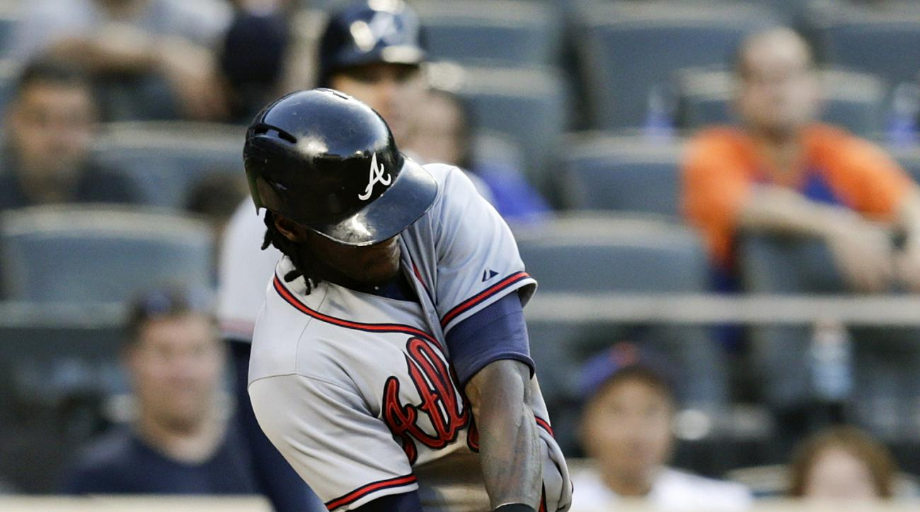 Atlanta Braves' Cameron Maybin (25) hits a two-run single during the eleventh inning of a baseball game against the New York Mets Saturday, June 13, 2015, in New York. (AP Photo/Frank Franklin II)