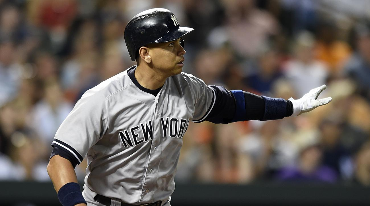 New York Yankees' Alex Rodriguez drops his bat after hitting a two-run home run against the Baltimore Orioles during the sixth inning of a baseball game Saturday, June 13, 2015, in Baltimore.(AP Photo/Gail Burton)