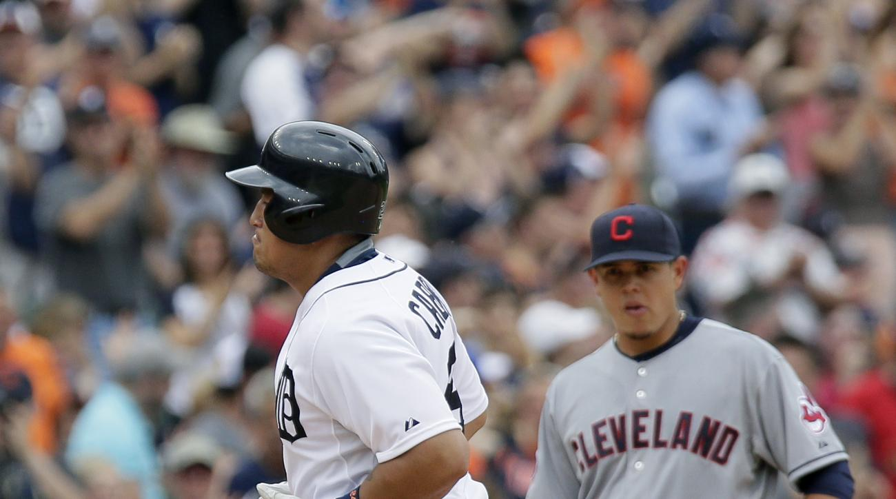 Detroit Tigers' Miguel Cabrera, left, rounds the bases past Cleveland Indians third baseman Giovanny Urshela after hitting a solo home run in a baseball game, Sunday, June 14, 2015, in Detroit. (AP Photo/Duane Burleson)