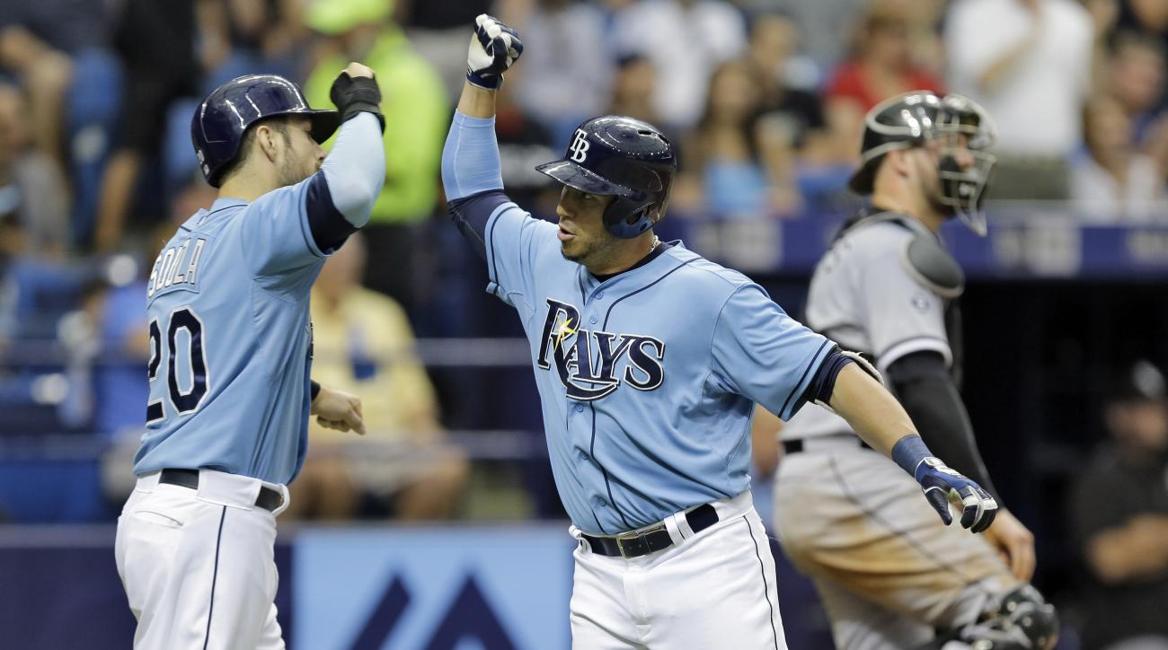 Tampa Bay Rays' Asdrubal Cabrera, front right, high-fives teammate Steven Souza Jr., left, after hitting a two-run home run off Chicago White Sox starting pitcher Chris Sale during the seventh inning of a baseball game Sunday, June 14, 2015, in St. Peters