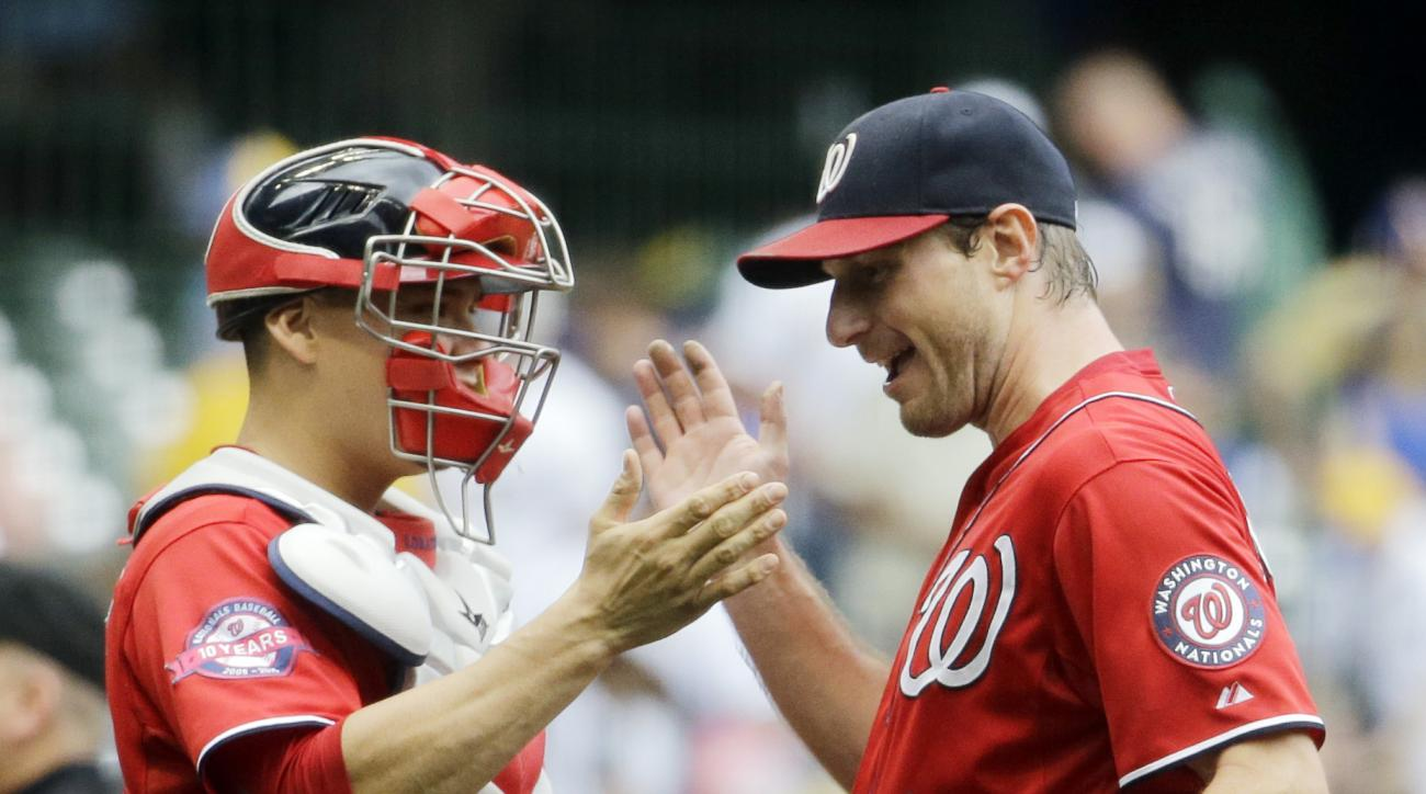 Washington Nationals starting pitcher Max Scherzer is congratulated by catcher Jose Lobaton after a baseball game against the Milwaukee Brewers Sunday, June 14, 2015, in Milwaukee. Scherzer threw a complete game one-hitter as the Nationals won 4-0. (AP Ph