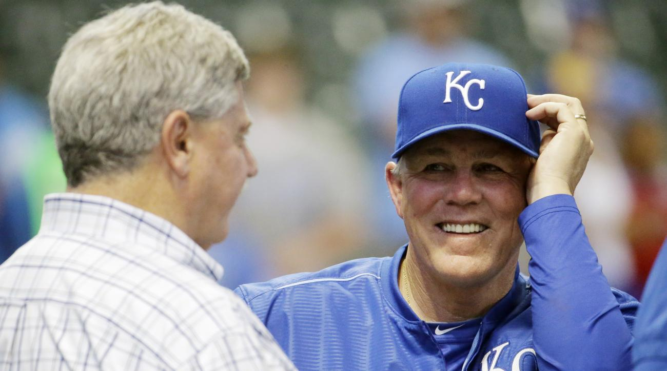 Milwaukee Brewers general manager Doug Melvin, left, talks to Kansas City Royals manager Ned Yost before a baseball game Monday, June 15, 2015, in Milwaukee. Yost managed the Brewers from 2003-2008. (AP Photo/Morry Gash)