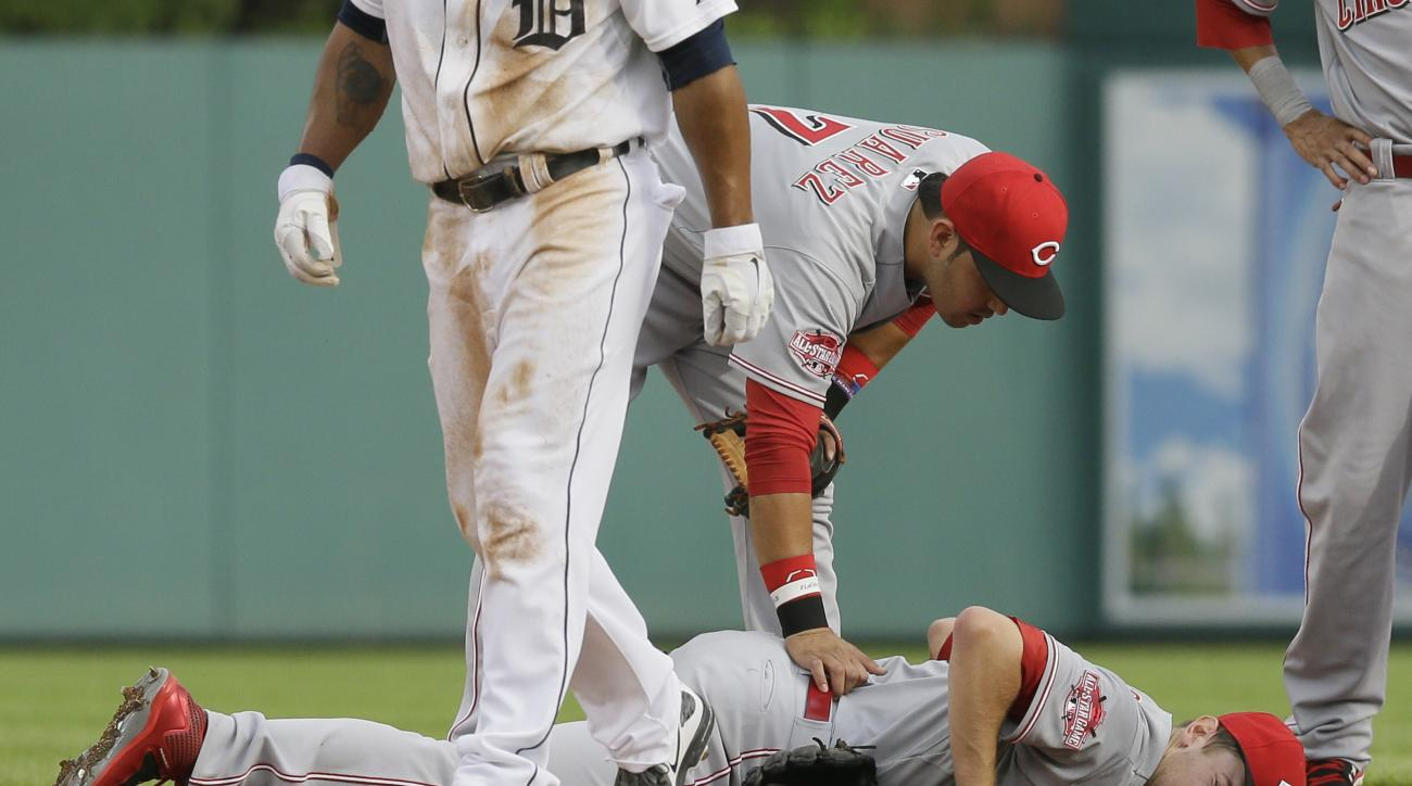 Cincinnati Reds starting pitcher Jon Moscot lies face-down on second after a tag of Detroit Tigers' Anthony Gose during a rundown in the first inning of a baseball game, Monday, June 15, 2015, in Detroit. (AP Photo/Carlos Osorio)