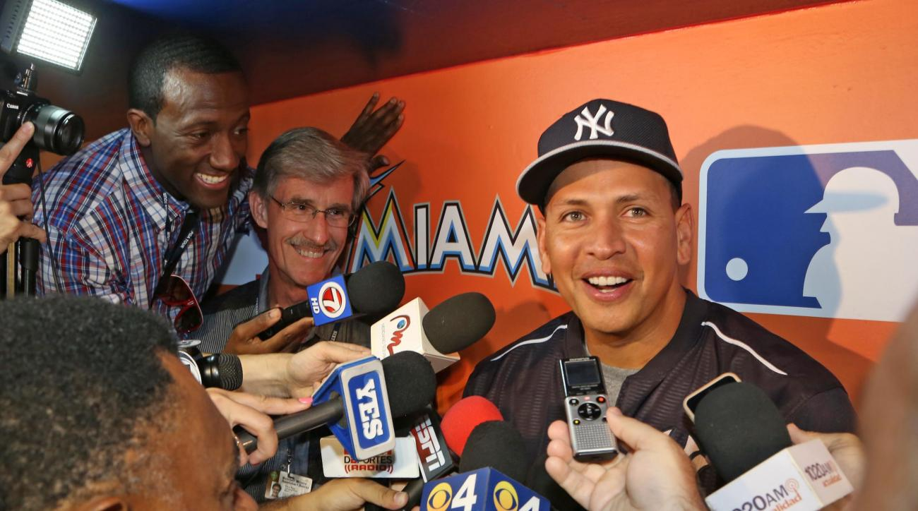 New York Yankees' Alex Rodriguez talks to reporters in the dugout before the Yankees' baseball game against the Miami Marlins on Monday, June 15, 2015, in Miami. (Hector Gabino/El Nuevo Herald via AP)