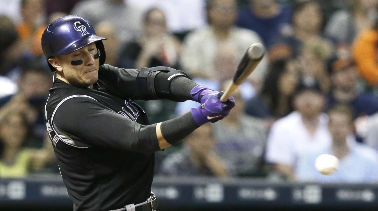Colorado Rockies' Troy Tulowitzki grounds out to Houston Astros shortstop Carlos Correa during the fourth inning of a baseball game Monday, June 15, 2015, in Houston. (AP Photo/Pat Sullivan)