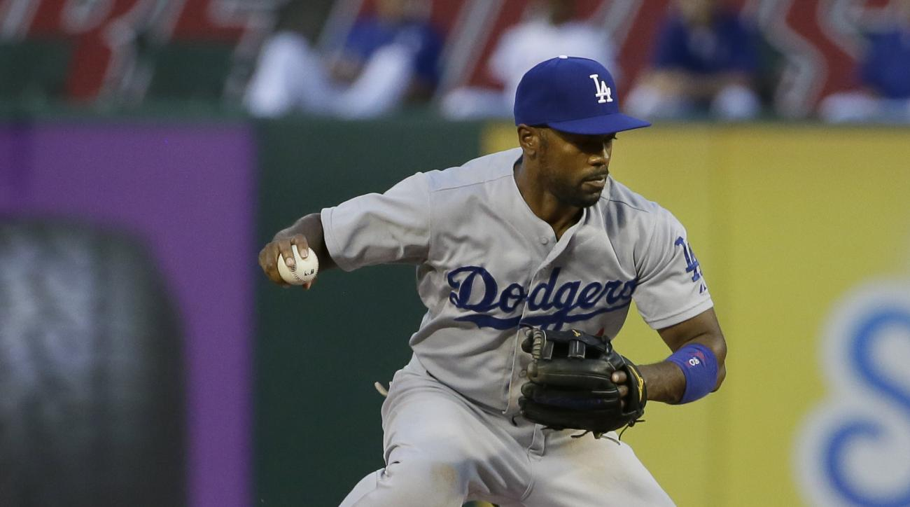 Los Angeles Dodgers shortstop Jimmy Rollins (11) jumps over a sliding Texas Rangers Rougned Odor at second base breaking up the double play attempt during the fifth inning of a baseball game in Arlington, Texas, Monday, June 15, 2015. Rangers Leonys Marti