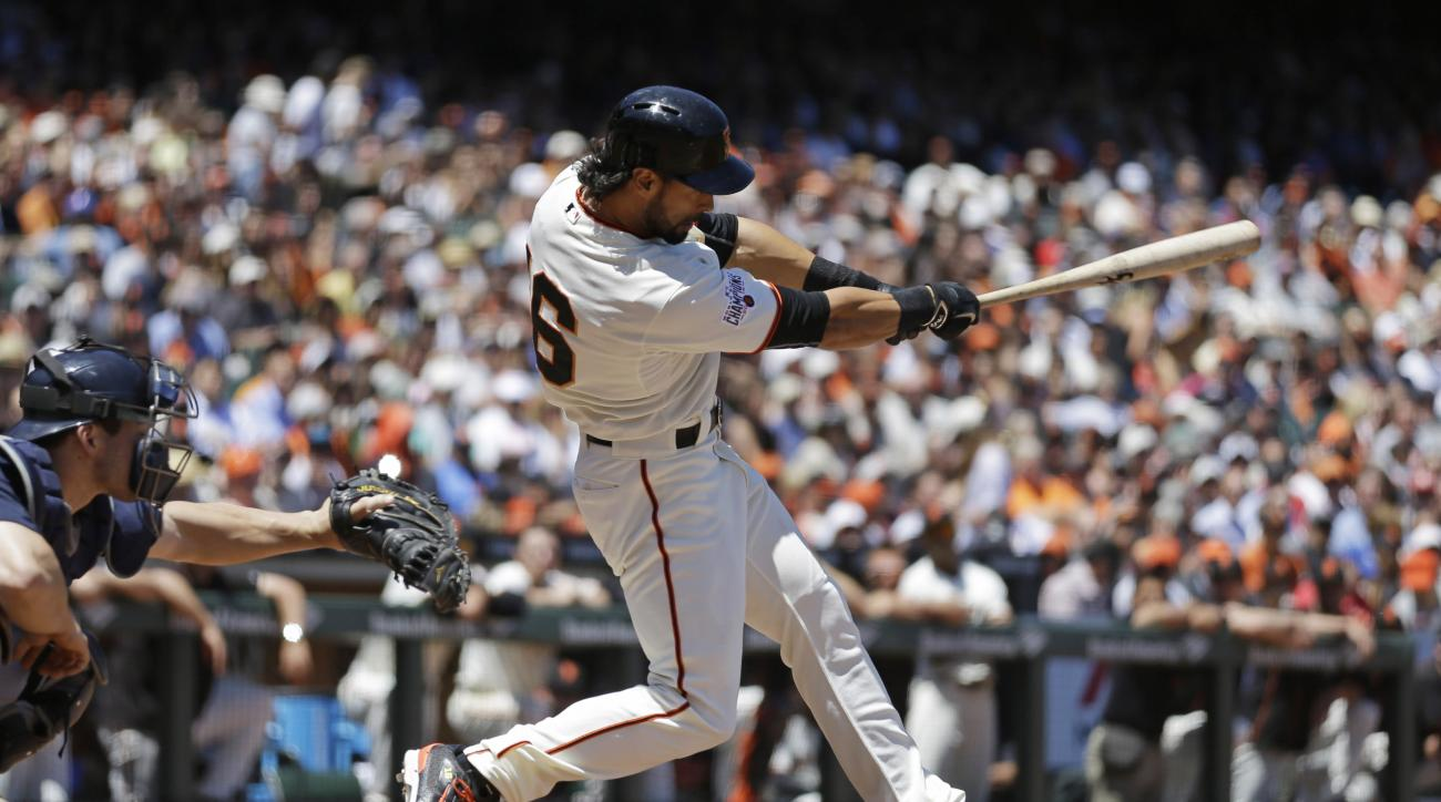San Francisco Giants' Angel Pagan swings for an RBI single off Seattle Mariners' J.A. Happ in the fifth inning of a baseball game Tuesday, June 16, 2015, in San Francisco. (AP Photo/Ben Margot)