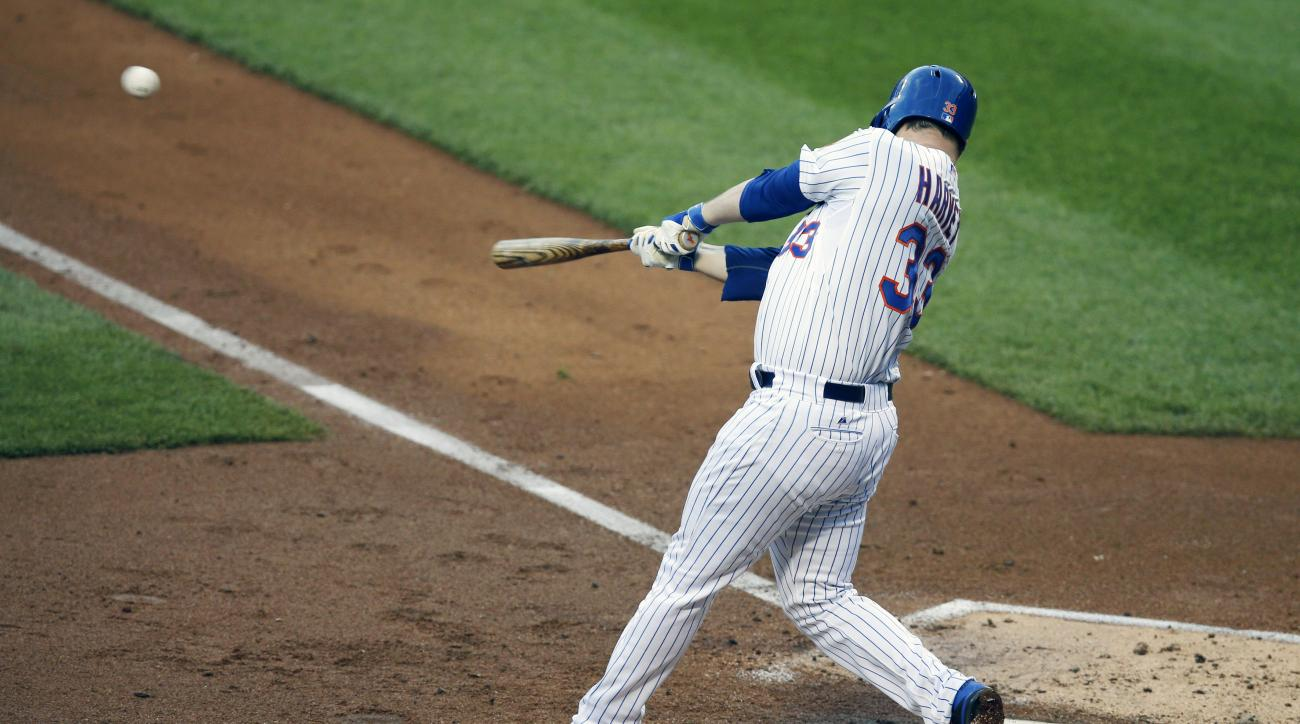 New York Mets starting pitcher Matt Harvey (33) hits a second-inning, RBI double in a baseball game against the Toronto Blue Jays in New York, Tuesday, June 16, 2015. (AP Photo/Kathy Willens)