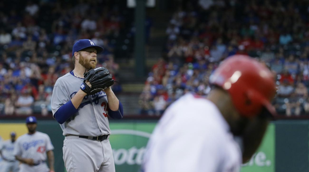 Los Angeles Dodgers starting pitcher Brett Anderson waits as Texas Rangers'  Prince Fielder heads home to score on a bases-loaded walk during the first inning of a baseball game in Arlington, Texas, Tuesday, June 16, 2015. (AP Photo/LM Otero)