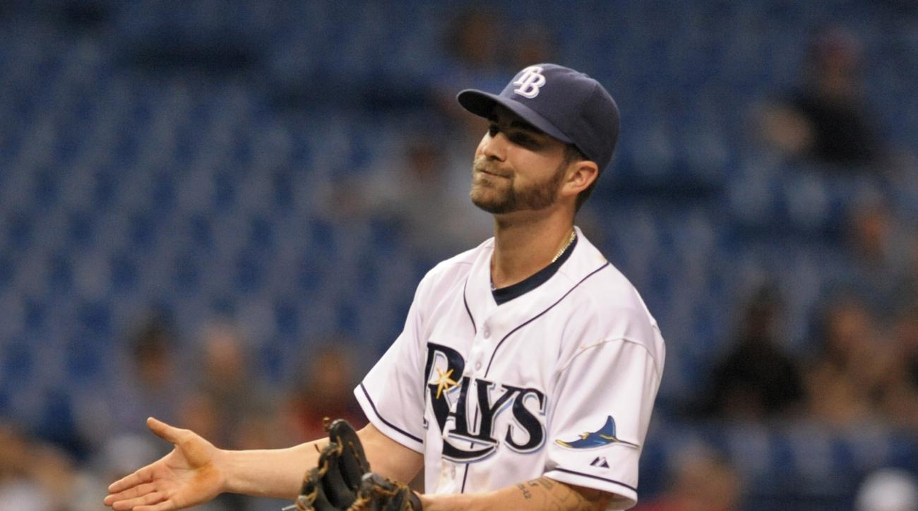 Tampa Bay Rays infielder Nick Franklin, pitching in relief, gestures toward Washington Nationals batter Danny Espinosa after hitting him with a pitch during the ninth inning of a baseball game Tuesday, June 16, 2015, in St. Petersburg, Fla. The Nationals