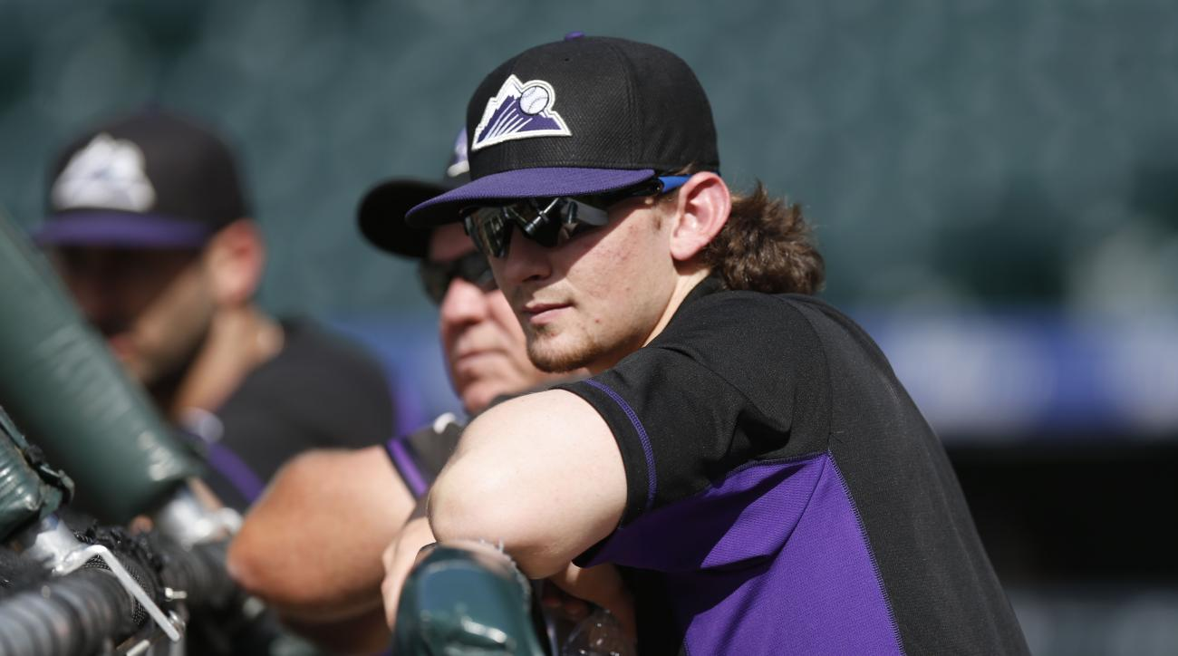 Brendan Rodgers, a shortstop from Lake Mary High School in Lake Mary, Fla., looks on at batting practice from behind the cage after signing a contract with the Colorado Rockies, who picked him in the first-round of the Major League Baseball Draft, Wednesd