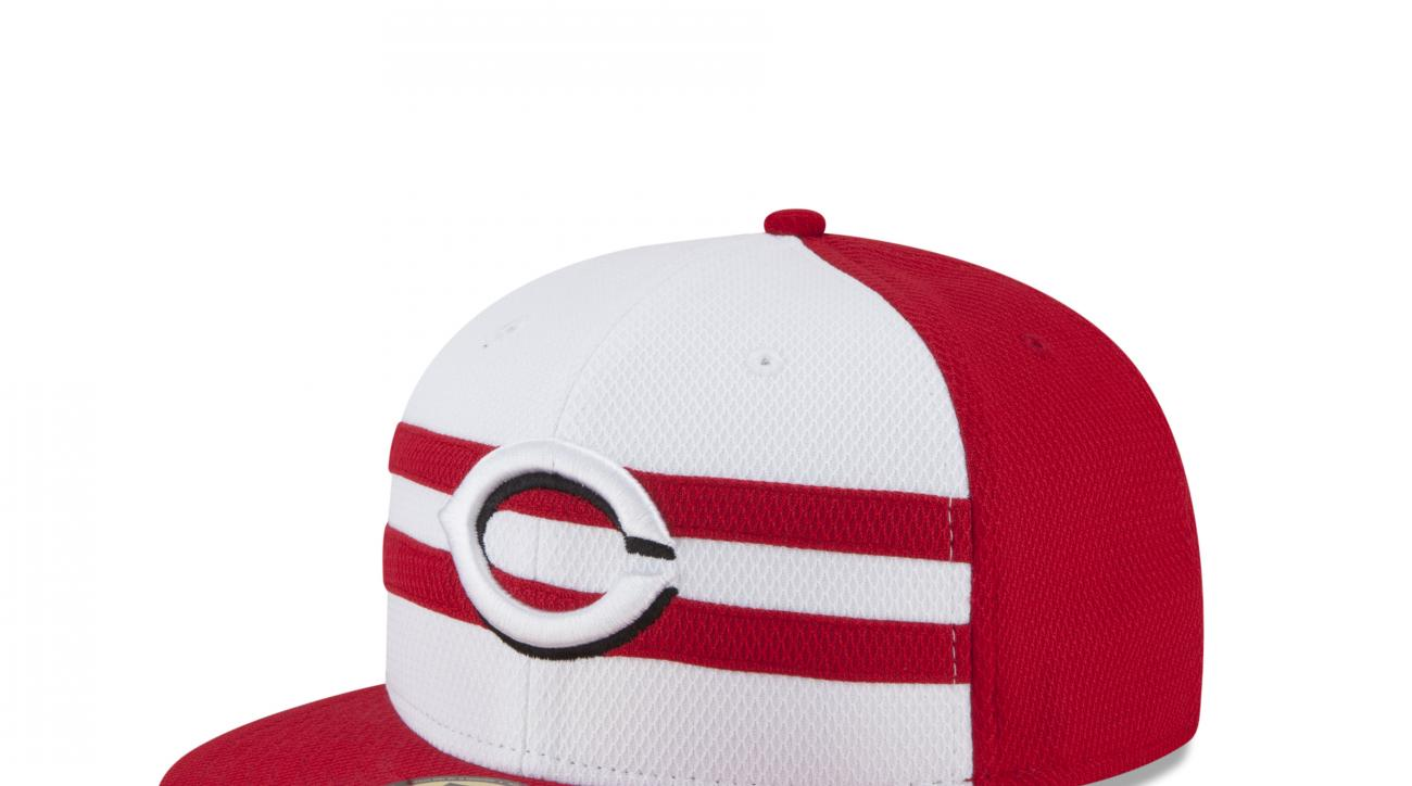 In an image provided by DKC News, the design of a baseball cap that will be worn by Cincinnati Reds players in the All-Star game in Cincinnati is shown. Major League Baseball and New Era said Wednesday, June 17, 2015, that each cap will have two stripes a