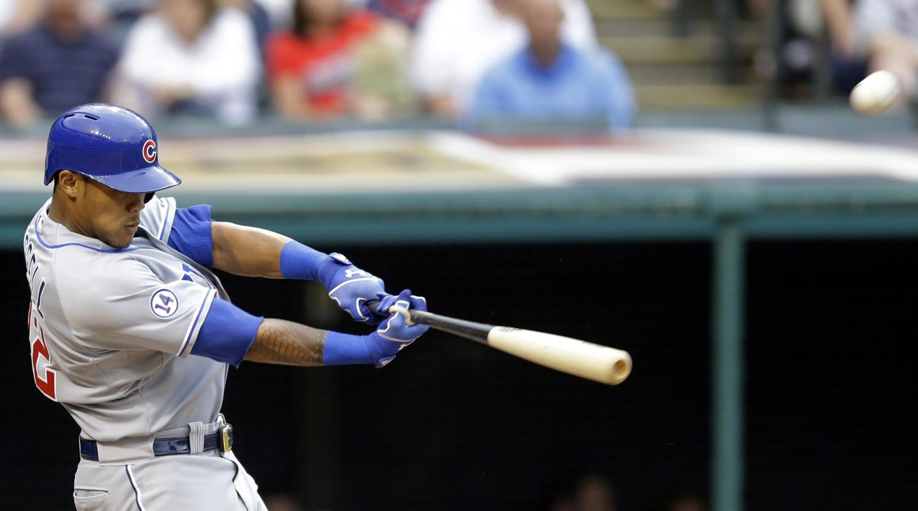-Chicago Cubs' Addison Russell hits a two-run home run off Cleveland Indians starting pitcher Shaun Marcum during the second inning of a baseball game, Wednesday, June 17, 2015, in Cleveland. (AP Photo/Tony Dejak)
