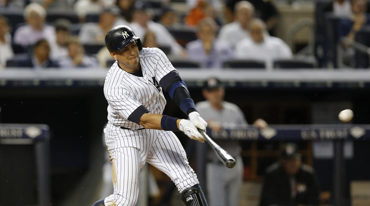 New York Yankees designated hitter Alex Rodriguez (13) swings on a single during the fifth inning of a baseball game against the Miami Marlins at Yankee Stadium in New York, Wednesday, June 17, 2015. (AP Photo/Kathy Willens)