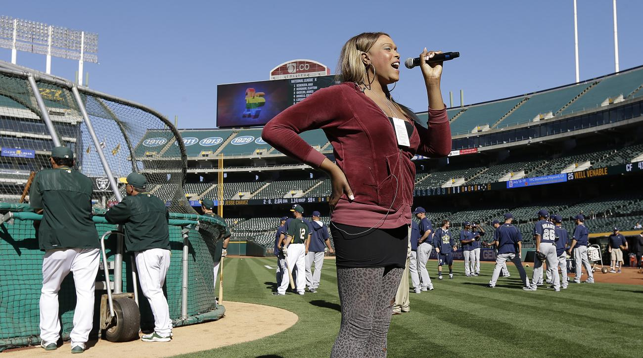 Breanna Sinclaire practices the national anthem prior to the baseball game between the San Diego Padres and the Oakland Athletics Wednesday, June 17, 2015, in Oakland, Calif. (AP Photo/Ben Margot)