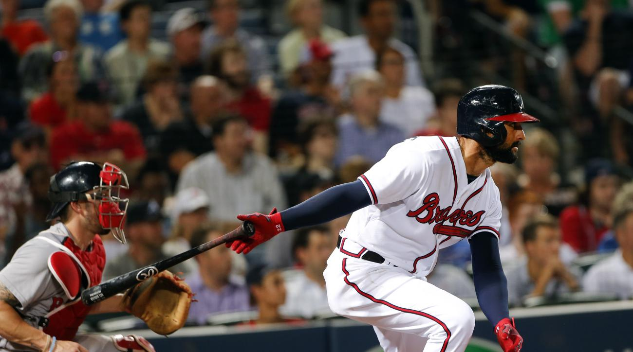 Atlanta Braves right fielder Nick Markakis (22) puts the Braves ahead with an RBI-base hit as Boston Red Sox catcher Blake Swihart (23) looks on in the seventh inning of a baseball game Wednesday, June 17, 2015, in Atlanta. (AP Photo/John Bazemore)
