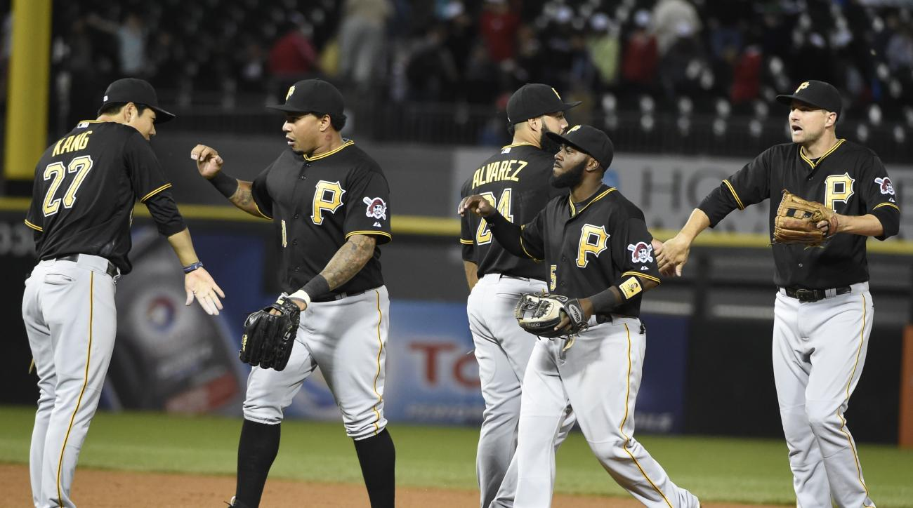 The Pittsburgh Pirates celebrate their 3-2 win over the Chicago White Sox in a baseball game, Wednesday, June 17, 2015, in Chicago. (AP Photo/David Banks)