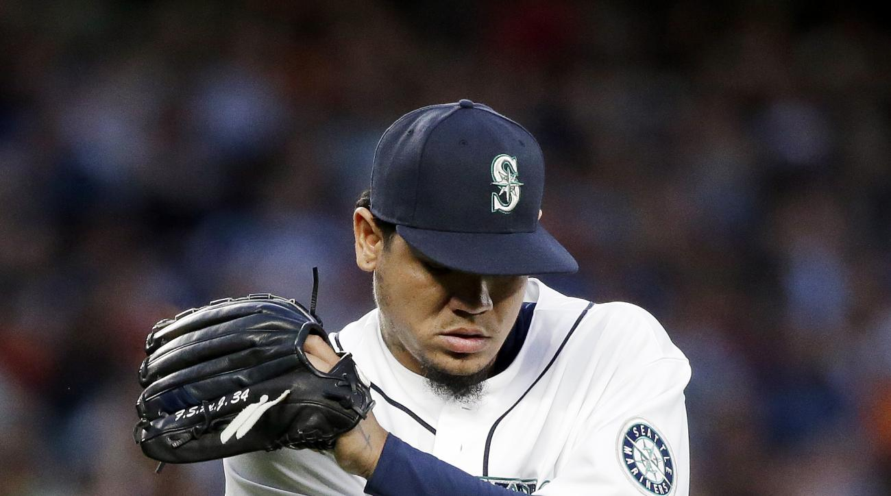 Seattle Mariners starting pitcher Felix Hernandez reacts to the final out by the San Francisco Giants, leaving a pair of runners stranded, in the seventh inning of a baseball game Wednesday, June 17, 2015, in Seattle. (AP Photo/Elaine Thompson)