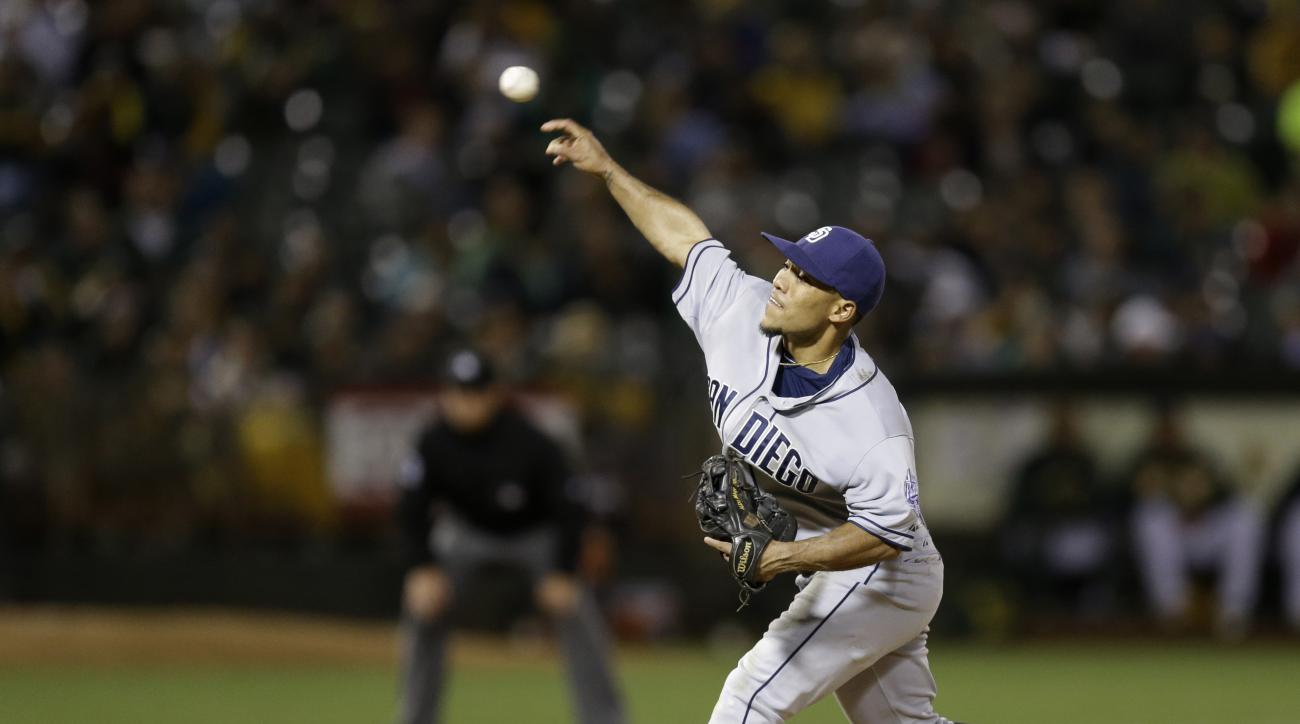 San Diego Padres shortstop Alexi Amarista pitches against the Oakland Athletics in the eighth inning of a baseball game Wednesday, June 17, 2015, in Oakland, Calif. (AP Photo/Ben Margot)