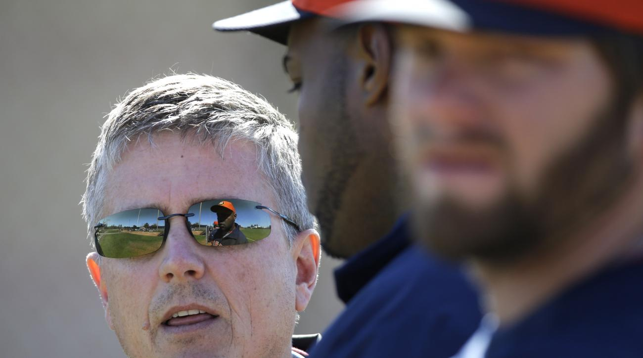 FILE - In this Feb. 18, 2013, file photo, Houston Astros general manager Jeff Luhnow, left, talks with players during a spring training baseball workout in Kissimmee, Fla. The analytical approach helped the St. Louis Cardinals with the World Series in 201