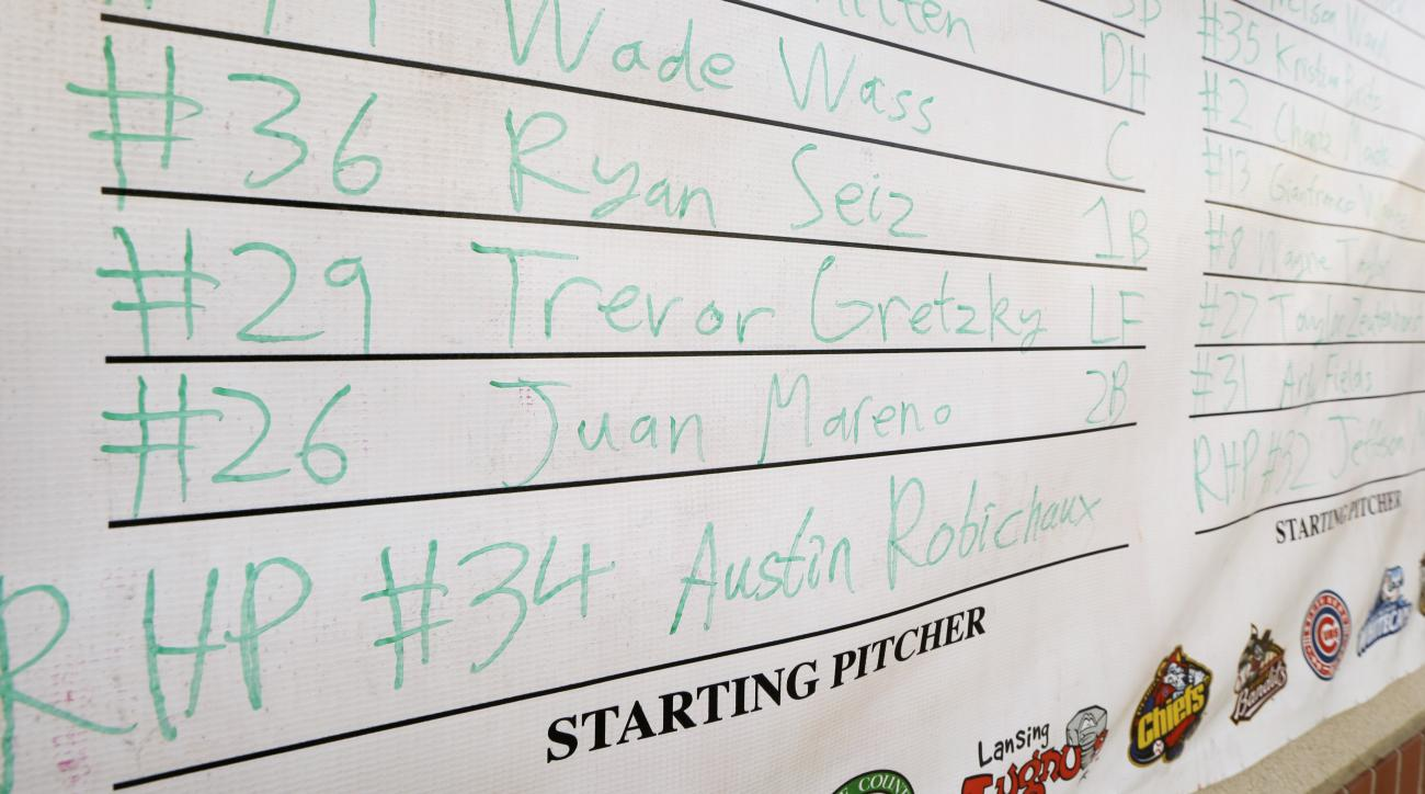 In this photo taken May 22, 2015, Burlington Bees outfielder Trevor Gretzky's name is written in a lineup poster before a minor league baseball game against the Clinton LumberKings in Clinton, Iowa. Gretzky, the son of hockey legend Wayne Gretzky, is toil