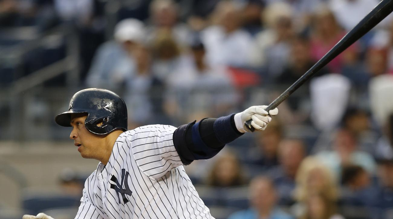 New York Yankees designated hitter Alex Rodriguez hits a first-inning, RBI single in a baseball game against the Miami Marlins at Yankee Stadium in New York, Thursday, June 18, 2015. (AP Photo/Kathy Willens)