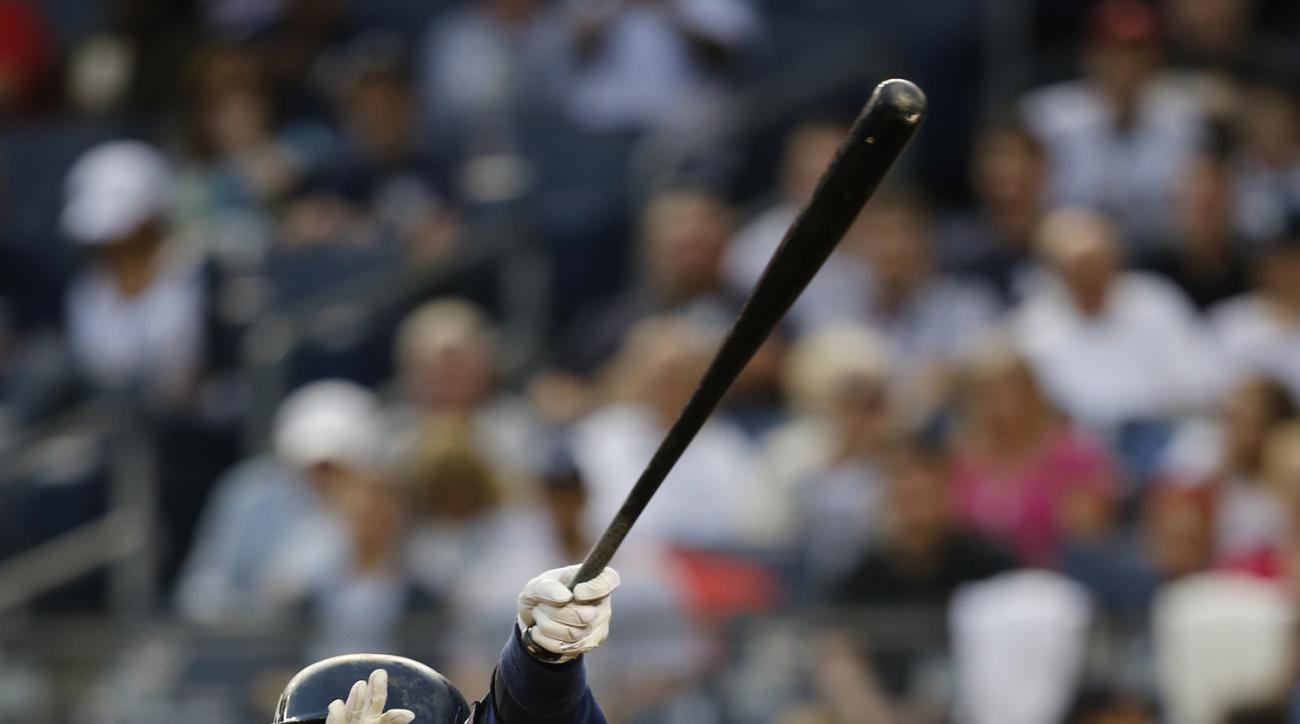 New York Yankees designated hitter Alex Rodriguez follows through on a first-inning, RBI, single in a baseball game against the Miami Marlins at Yankee Stadium in New York, Thursday, June 18, 2015. (AP Photo/Kathy Willens)