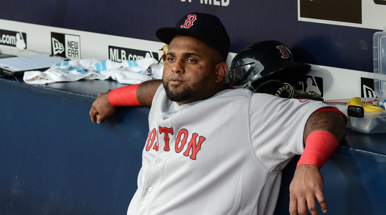 Boston Red Sox third baseman Pablo Sandoval (48) sits on the bench before the start of a baseball game against the Atlanta Braves Thursday, June 18, 2015, in Atlanta. Boston third baseman Pablo Sandoval has been benched by manager John Farrell after using