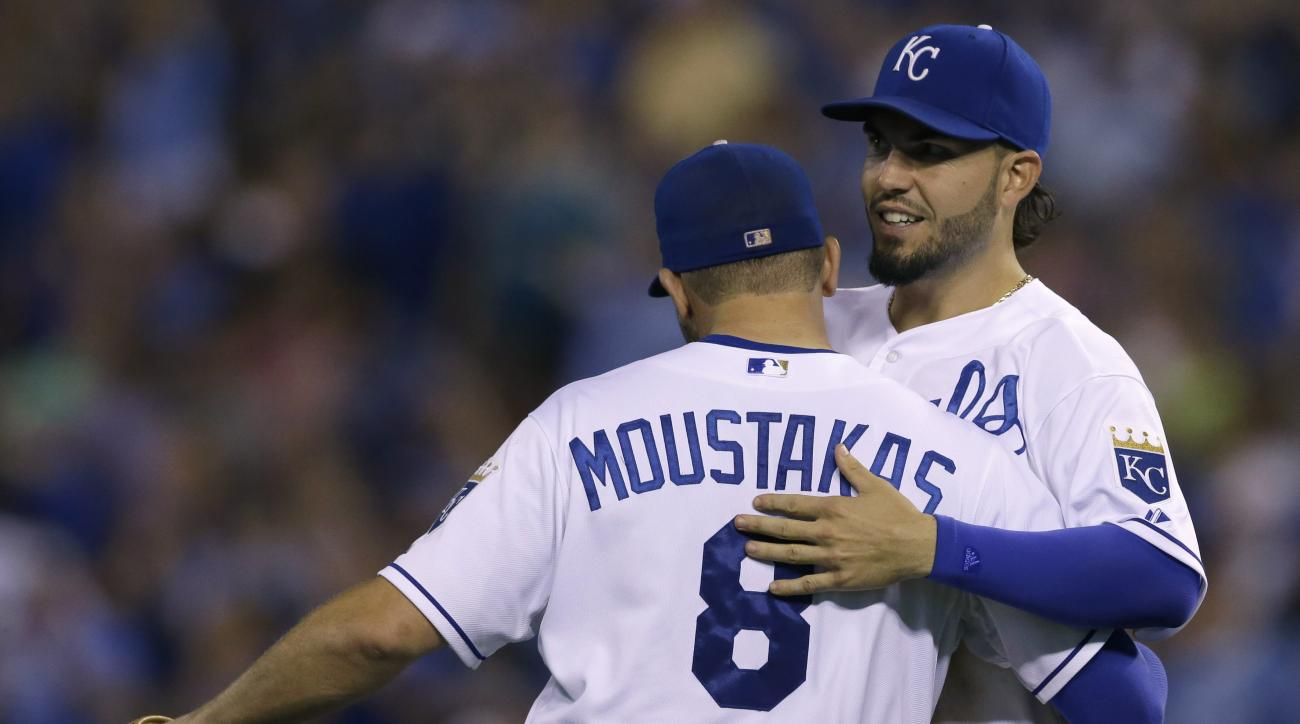 Kansas City Royals first baseman Eric Hosmer, right, and third baseman Mike Moustakas (8) celebrate following a baseball game against the Milwaukee Brewers at Kauffman Stadium in Kansas City, Mo., Thursday, June 18, 2015. The Royals defeated the Brewers 3