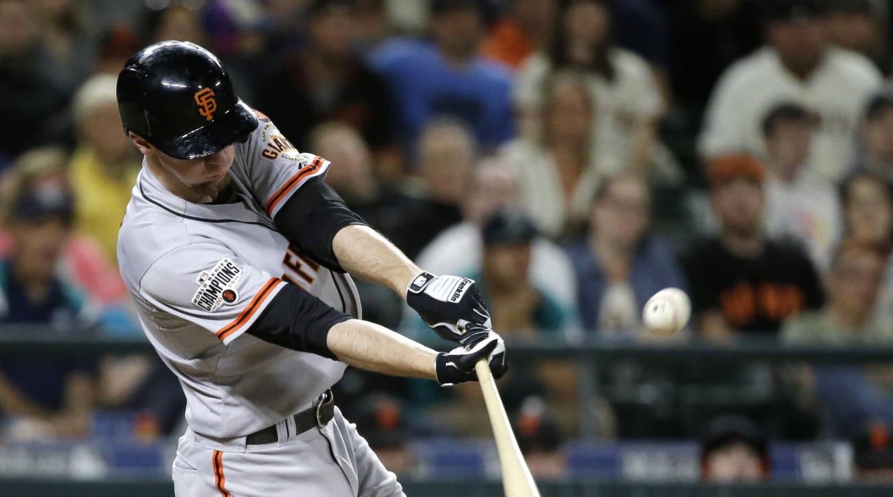 San Francisco Giants' Matt Duffy hits a two-run triple against the Seattle Mariners in the eighth inning of a baseball game Thursday, June 18, 2015, in Seattle. (AP Photo/Elaine Thompson)