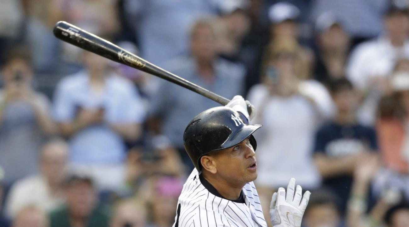 New York Yankees' Alex Rodriguez follows through on a home run for his 3,000th career hit, during the first inning of a baseball game against the Detroit Tigers on Friday, June 19, 2015, in New York. (AP Photo/Frank Franklin II)