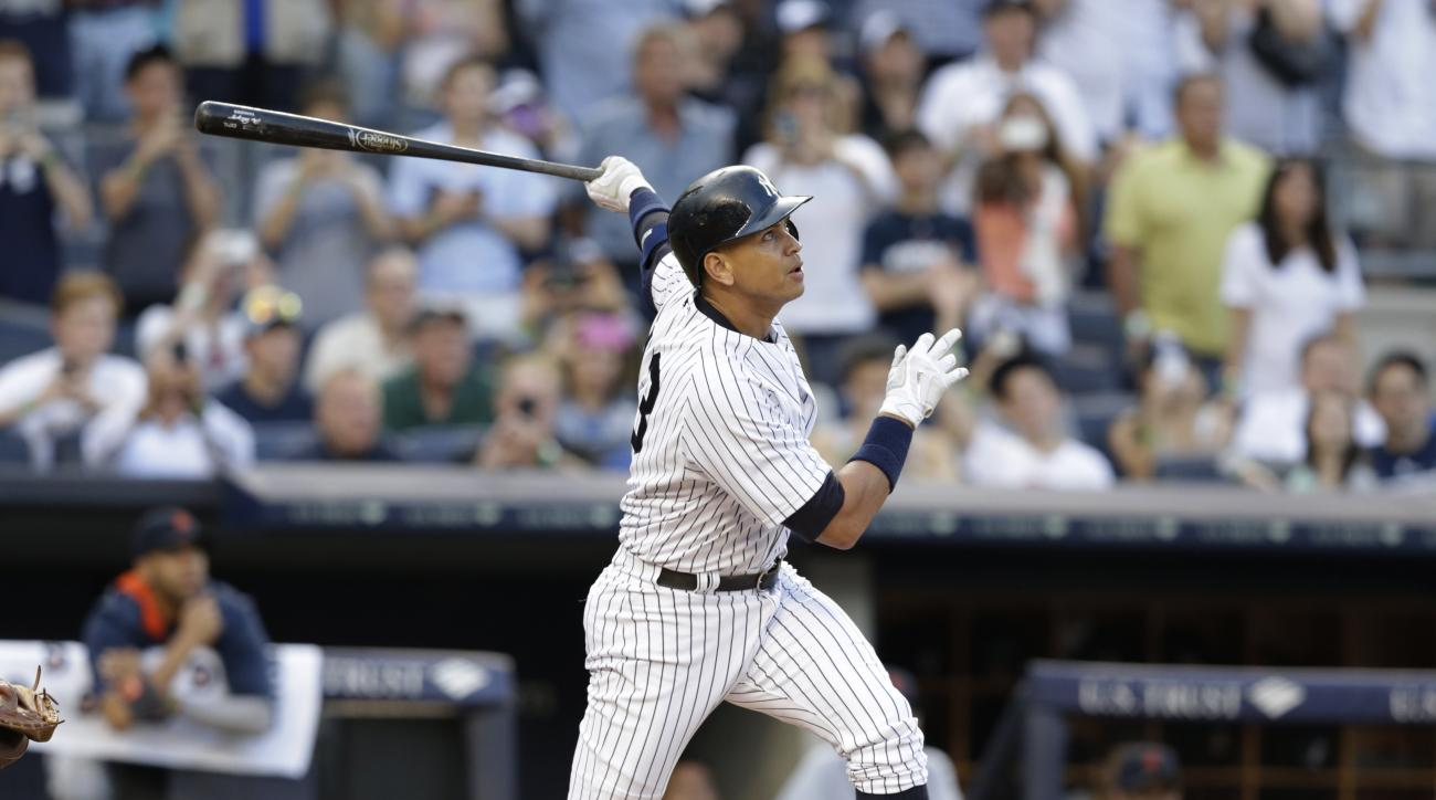 New York Yankees' Alex Rodriguez hits a home run for his 3,000th career hit, during the first inning of a baseball game against the Detroit Tigers Friday, June 19, 2015, in New York. (AP Photo/Frank Franklin II)