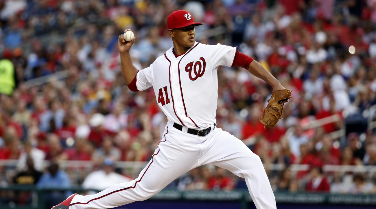 Washington Nationals starting pitcher Joe Ross (41) throws during the third inning of a baseball game against the Pittsburgh Pirates, Friday, June 19, 2015, in Washington. (AP Photo/Alex Brandon)