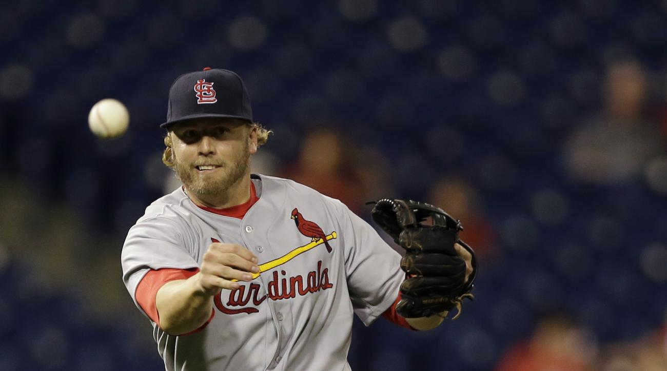 St. Louis Cardinals third baseman Mark Reynolds throws to first base on a ground out by Philadelphia Phillies' Maikel Franco during the eighth inning of a baseball game, Friday, June 19, 2015, in Philadelphia. St. Louis won 12-4. (AP Photo/Matt Slocum)