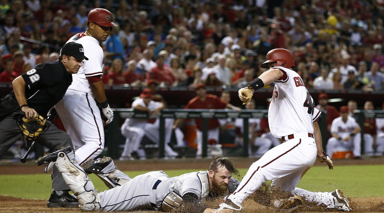 Arizona Diamondbacks' Paul Goldschmidt slides into home as San Diego Padres catcher Derek Norris reaches to tag him during the third inning of a baseball game Friday, June 19, 2015, in Phoenix. Goldschmidt was originally called safe, but after the play wa