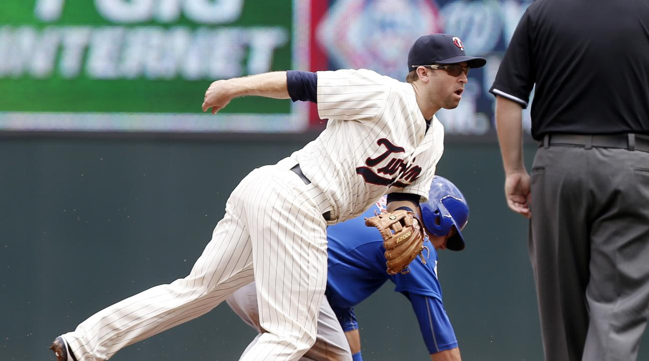 Minnesota Twins second baseman Brian Dozier, left, doubles up Chicago Cubs' Chris Denorfia at first after the force at second on Kyle Schwarber in the fourth inning of a baseball game, Saturday, June 20, 2015, in Minneapolis. (AP Photo/Jim Mone)