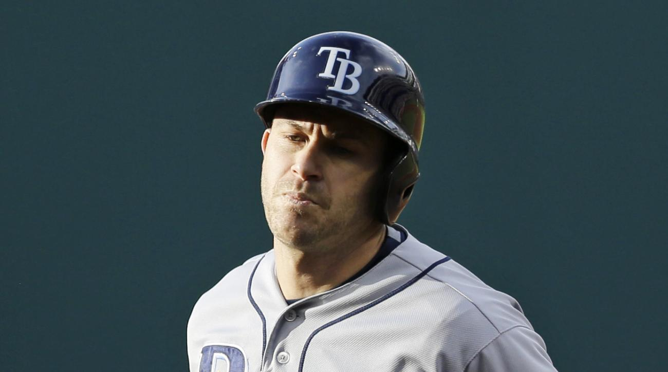 Tampa Bay Rays' Evan Longoria runs the bases after hitting a three-run home run off Cleveland Indians starting pitcher Corey Kluber in the first inning of a baseball game, Saturday, June 20, 2015, in Cleveland. Kevin Kiermaier and Joey Butler also scored
