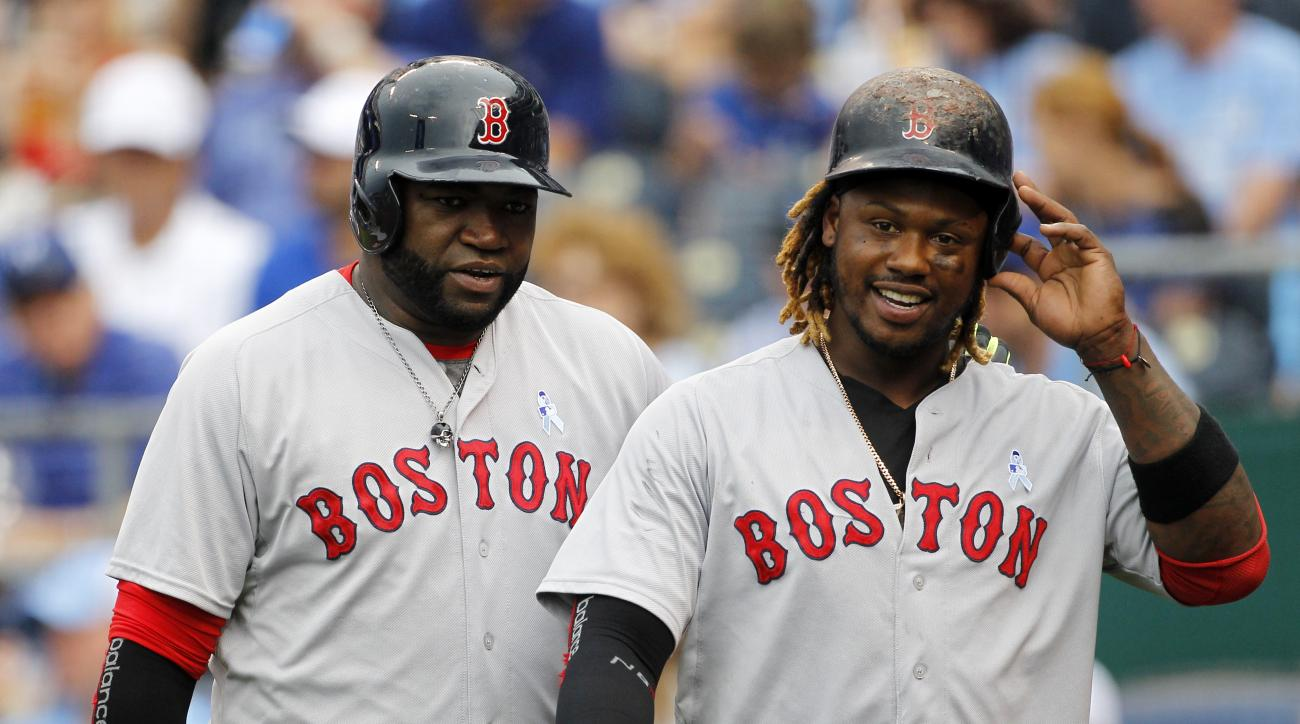 Boston Red Sox's David Ortiz, left, and Hanley Ramirez, right, head to the dugout after scoring on a Xander Bogaerts double in the fifth inning of a baseball game against the Kansas City Royals in Kansas City, Mo., Sunday, June 21, 2015. (AP Photo/Colin E