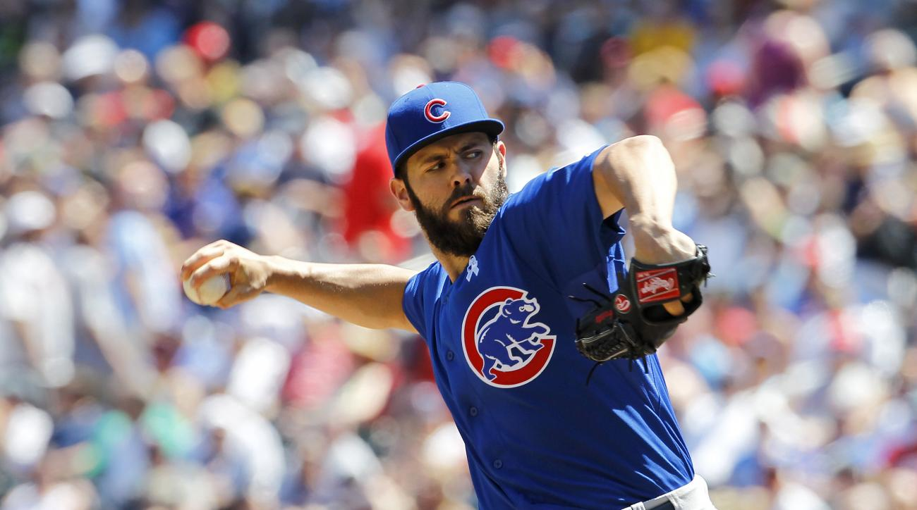 Chicago Cubs starting pitcher Jake Arrieta delivers to the Minnesota Twins during the fourth inning of a baseball game in Minneapolis, Sunday, June 21, 2015. (AP Photo/Ann Heisenfelt)